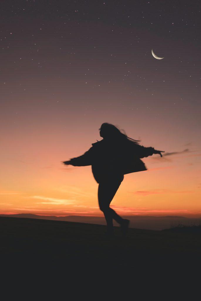 woman under moonlight